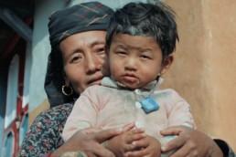 Film still - Nepali woman and child